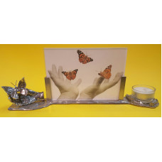 Photo frame with a hand and a butterfly